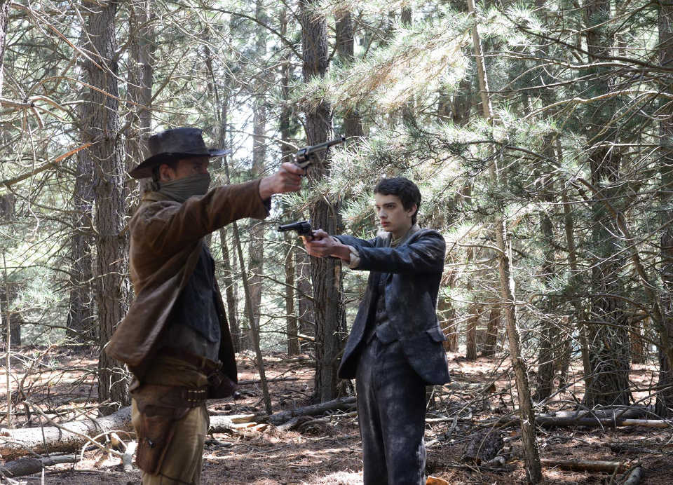 Michael Fassbender and Kodi Smit-McPhee draw pistols in John Maclean's revisionist western, Slow West