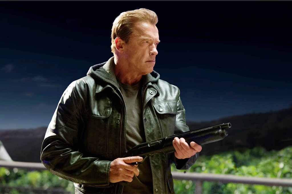 Arnold Schwarzengger carries a big gun